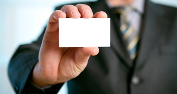 Man holding a printed business card
