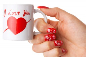 Lady holding white cup with I love you printed on