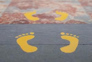 Printed yellow vinyl foot prints