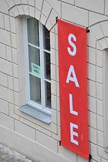 Red hanging banner with Sale printed on it