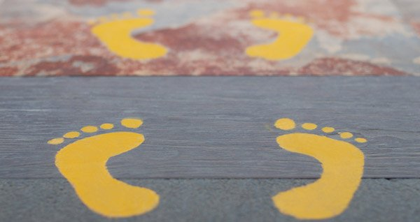 Printed vinyl non-slip floor graphic of foot prints