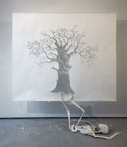 Paper art of tree and skeleton