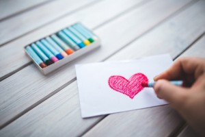 Drawing of a heart on a piece of paper with crayon