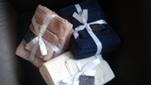 Assorted towels as gifts wrapped in ribbon
