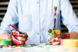 Messy artist wth colourful paint