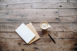 Cappuccino next to a card on a table