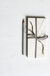 Present wrapped in gift wrap with a pencil