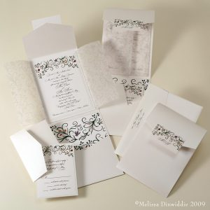 White wedding invitations, save the dates, and thank you cards