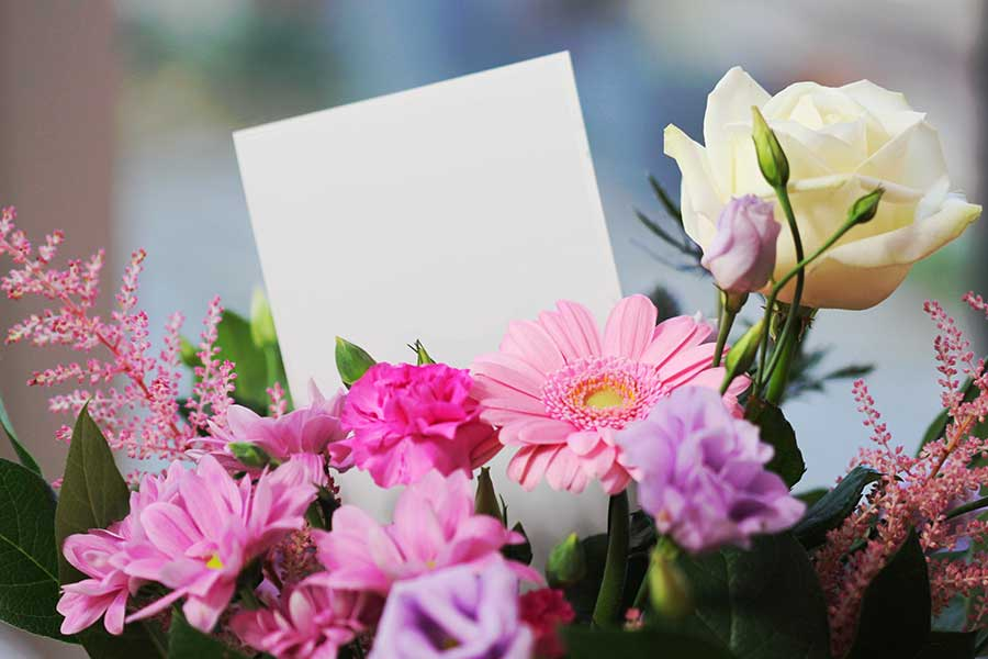 Bouquet of flowers with a card for a funeral